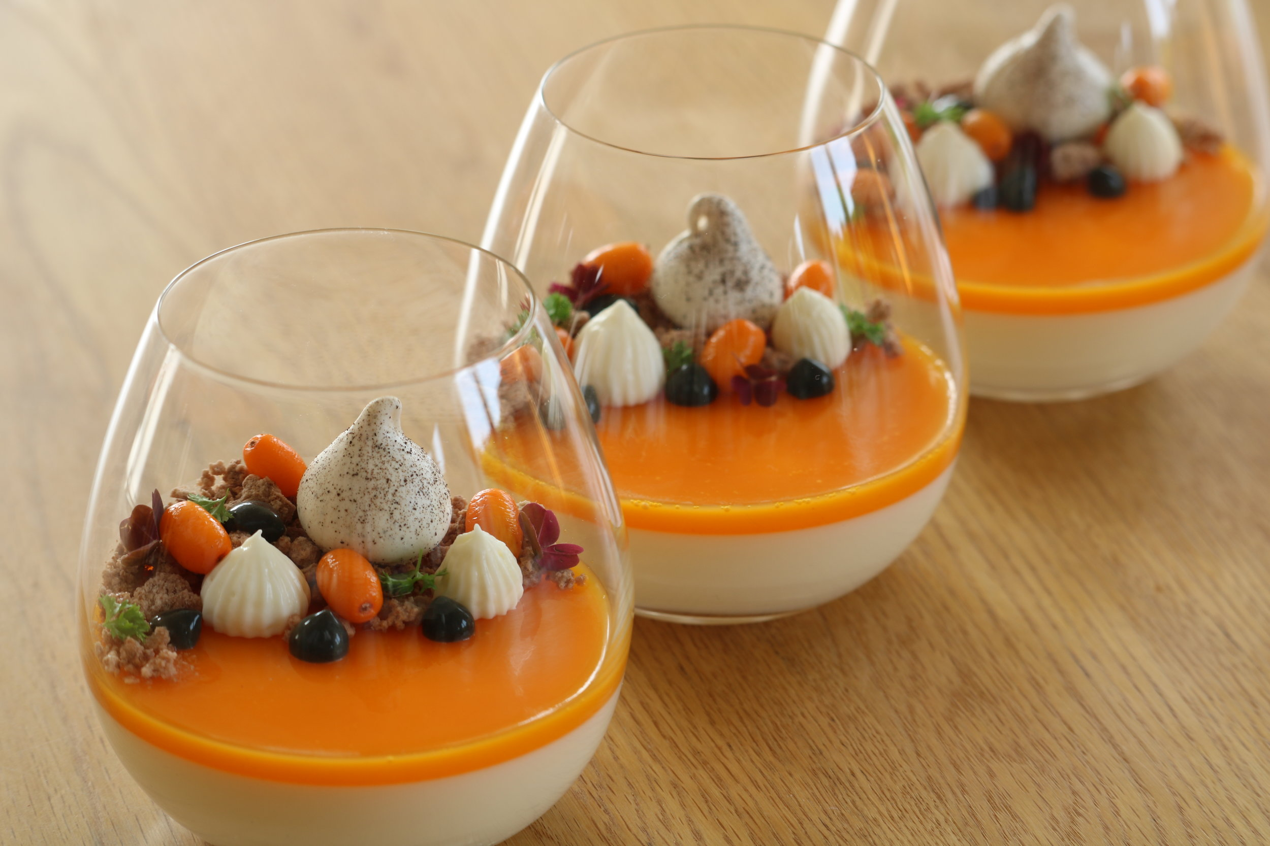 vanilla panna cotta with a cloudberry jelly