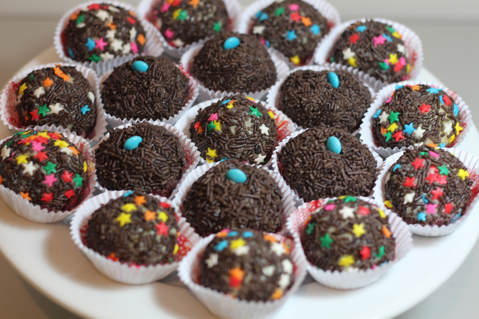The bite-size Brazilian chocolate dessert is traditionally coated in chocolate sprinkles, but can be topped with chopped nuts or shredded coconut too.