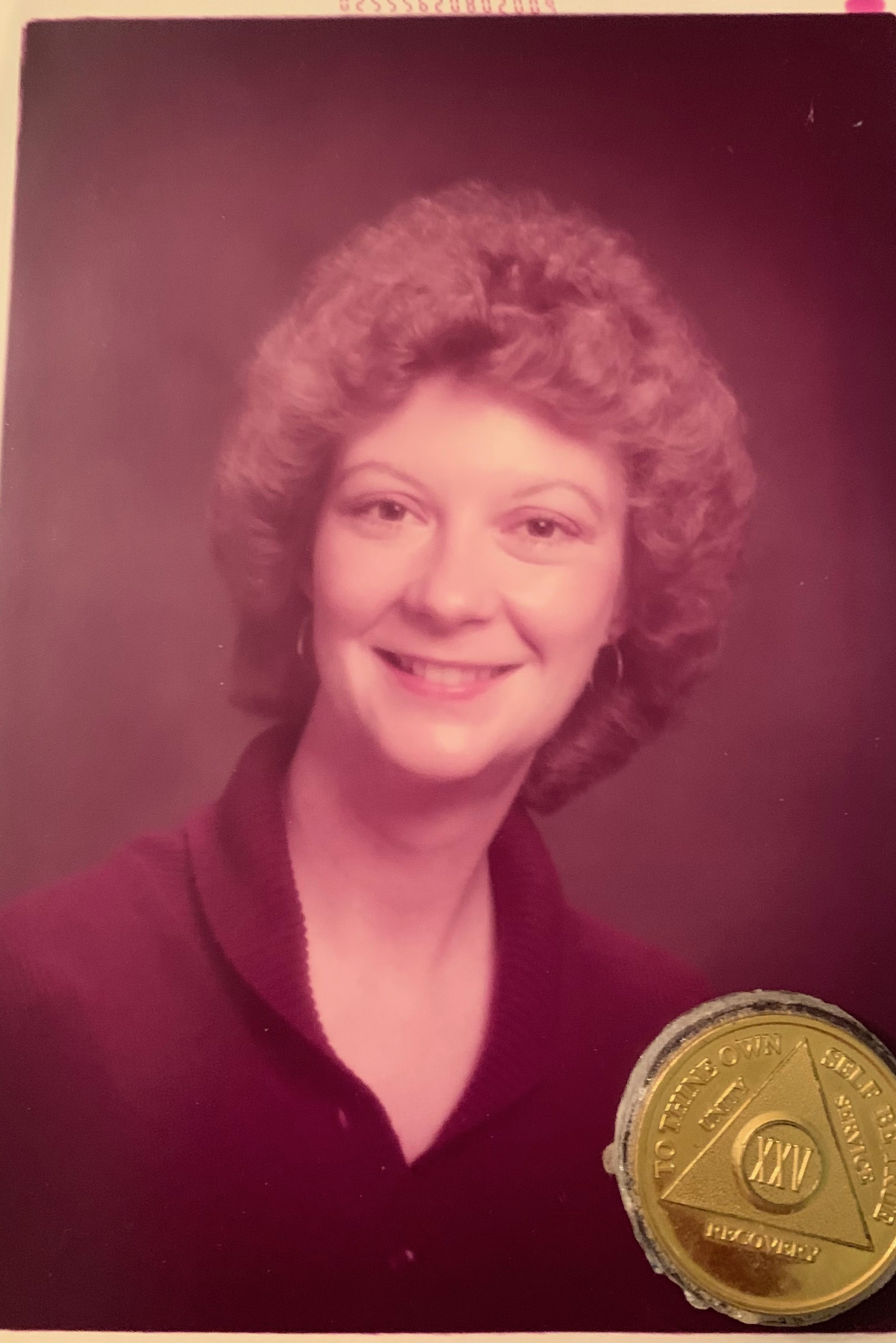 Jo White-Linnemon and her 25 Year Sobriety Chip.