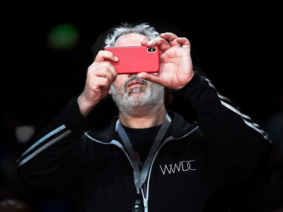 A phone-absorbed attendee at WWDC, where Apple announced a suite of features to limit distractions and recalibrate priorities on the iPhone. David Paul Morris /Bloomberg/Getty Images