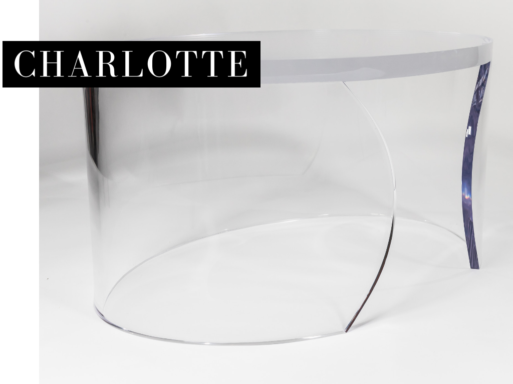 "COFFEE TABLE - _Charlotte de Beaune Semblancay, the mistress of King Henry IV of France, was part of the notorious ""Flying Squadron,"" a group of beautiful female spies known for using their feminine wiles to seduce important men. The Charlotte lucite cocktail table is sure to lure you in with its sexy curves yet nearly vanishes with the stealth of its namesake.Overall: 36"