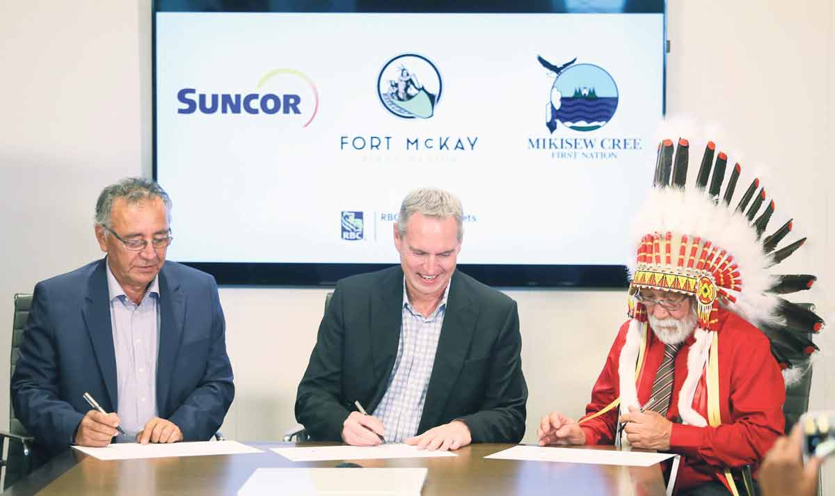 Suncor took a significant step towards working with Aboriginal Peoples to create opportunities for economic and social reconciliation in 2017 when Fort McKay and Mikisew Cree First Nations completed an acquisition of a 49 per cent partnership interest in the company's East Tank Farm Development. Signing the agreement, from left, are Fort McKay First Nation Chief Jim Boucher, Suncor president and COO Mark Little, and Mikisew Cree First Nation Chief Archie Waquan.  SUNCOR ENERGY INC.