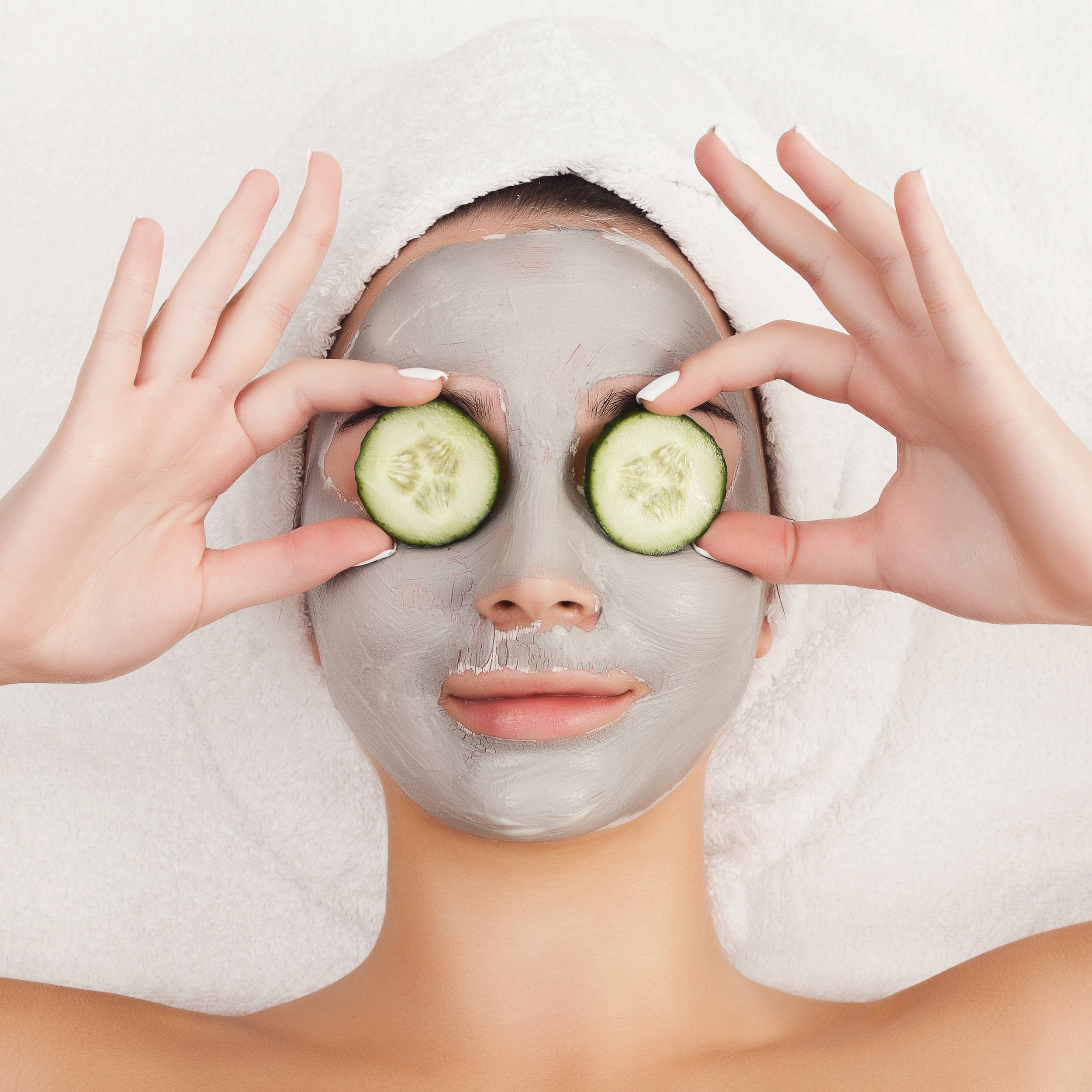 beautiful-girl-with-applied-clay-mask-at-white-PUNV5NM.jpg
