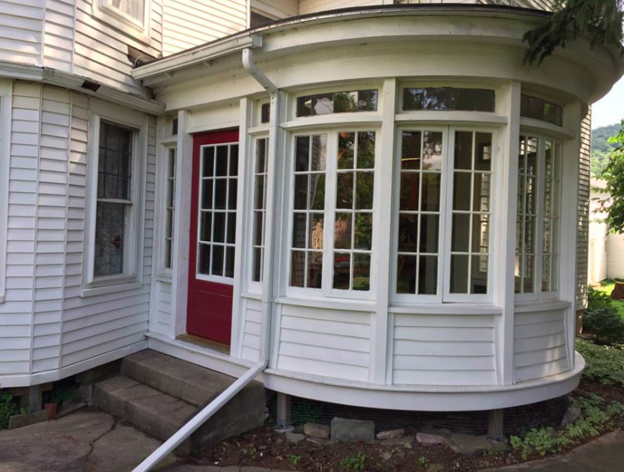 - The beautiful rounded porch diligently restored by Wayne.