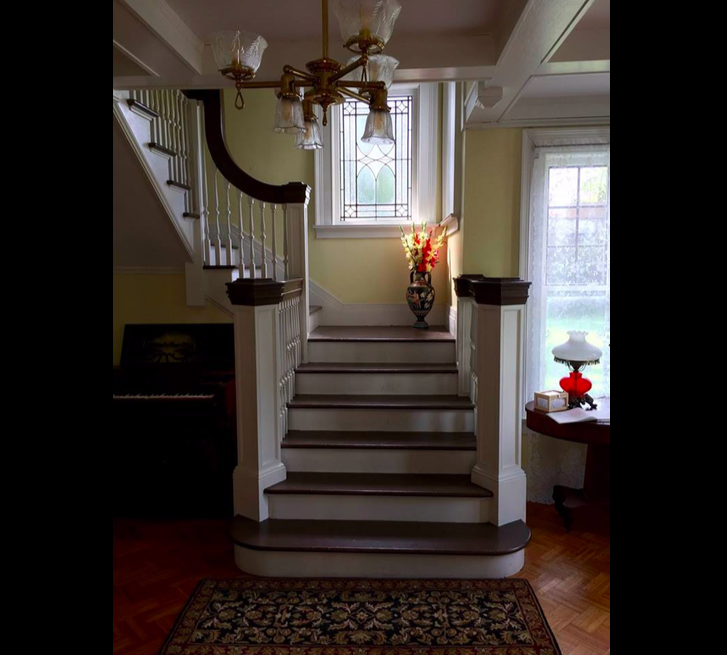 - The staircase. Notice the stained glass window.