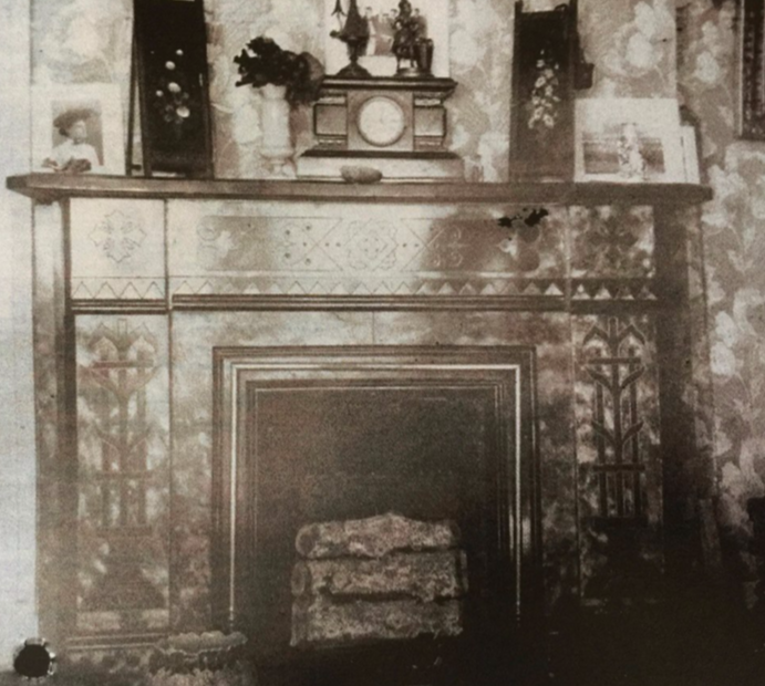 - An old photo of the fireplace in the sitting room. At one point (1926) the fireplace was updated to what you see today. Marble fireplaces were considered to be old fashioned.