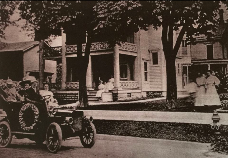 - The Maxfields owned some of the first automobiles in the village. This might be why Mr. Dunton across the street had gas pumps installed in front of his house. Here you can see Dennison driving his distinguished house guests in his 1901 Reo with his daughter Bessie beside him. His wife Mary, his other 3 daughters, Mary, Jane, and Helen, and his son, Hiram Jr., are pictured.