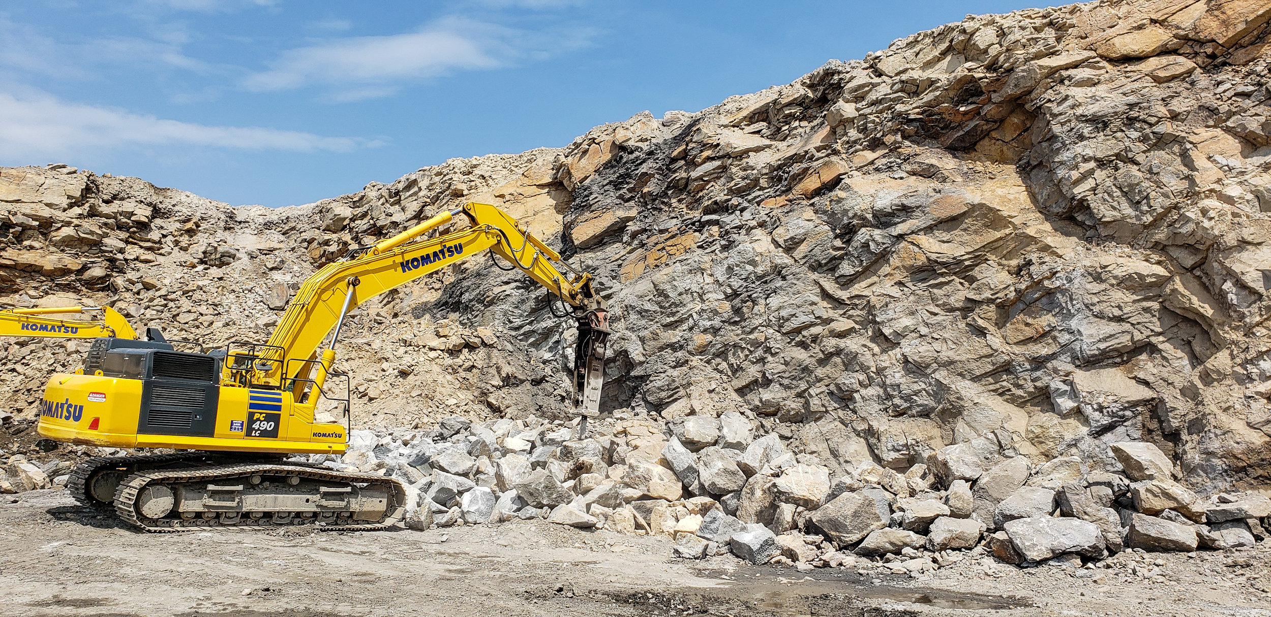 One of our 490 excavators hammering rock at our Middlport location.
