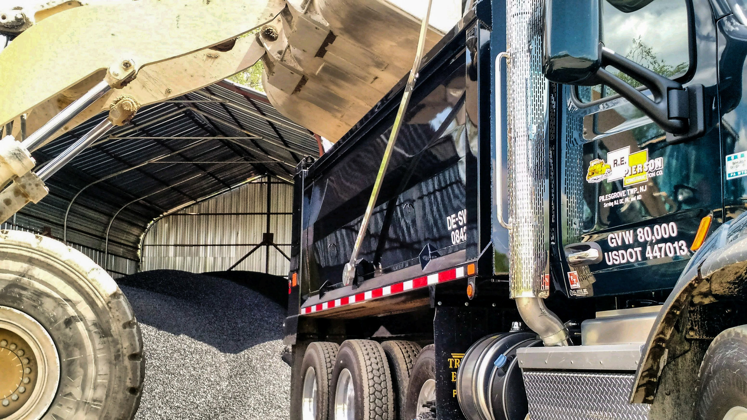 One of our 972K loaders loading a tri-axle with high performance cold patch at our Bridgeport location.