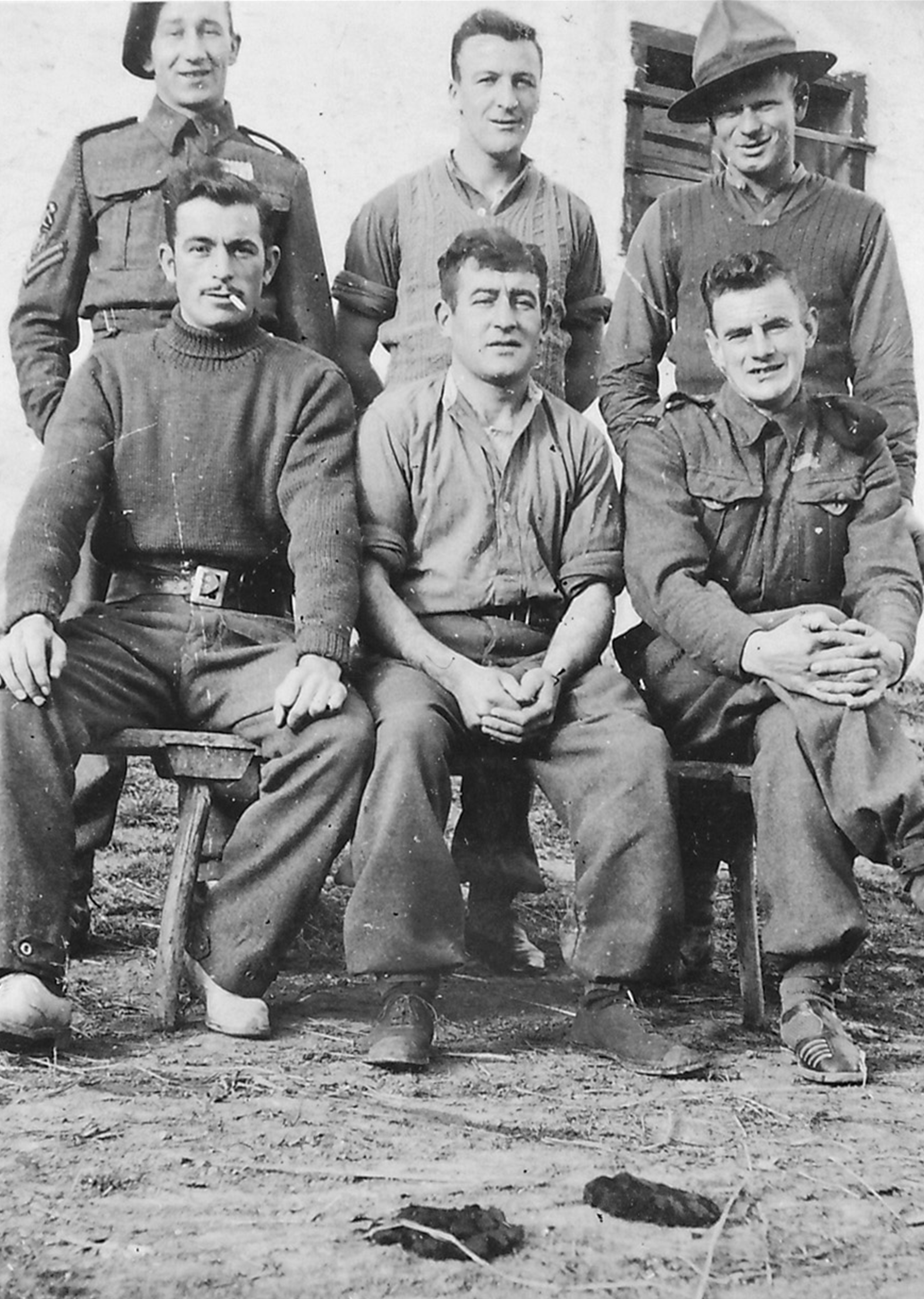 - Bruce Murray (back row, middle) with a Group of POW Farm Workers.