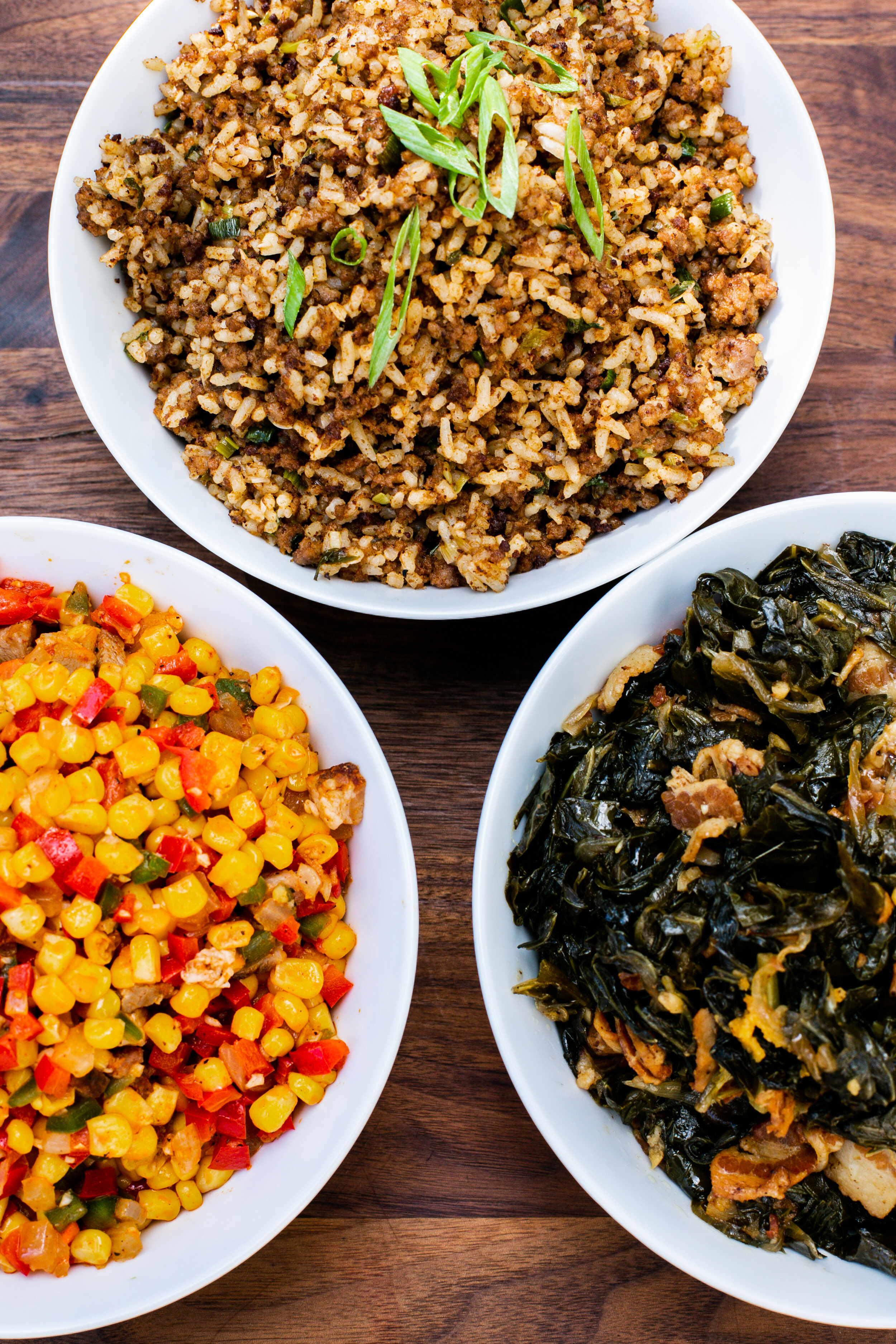 Corn and Tasso Maque Choux, Dirty Rice Dressing, Bacon Collard Greens