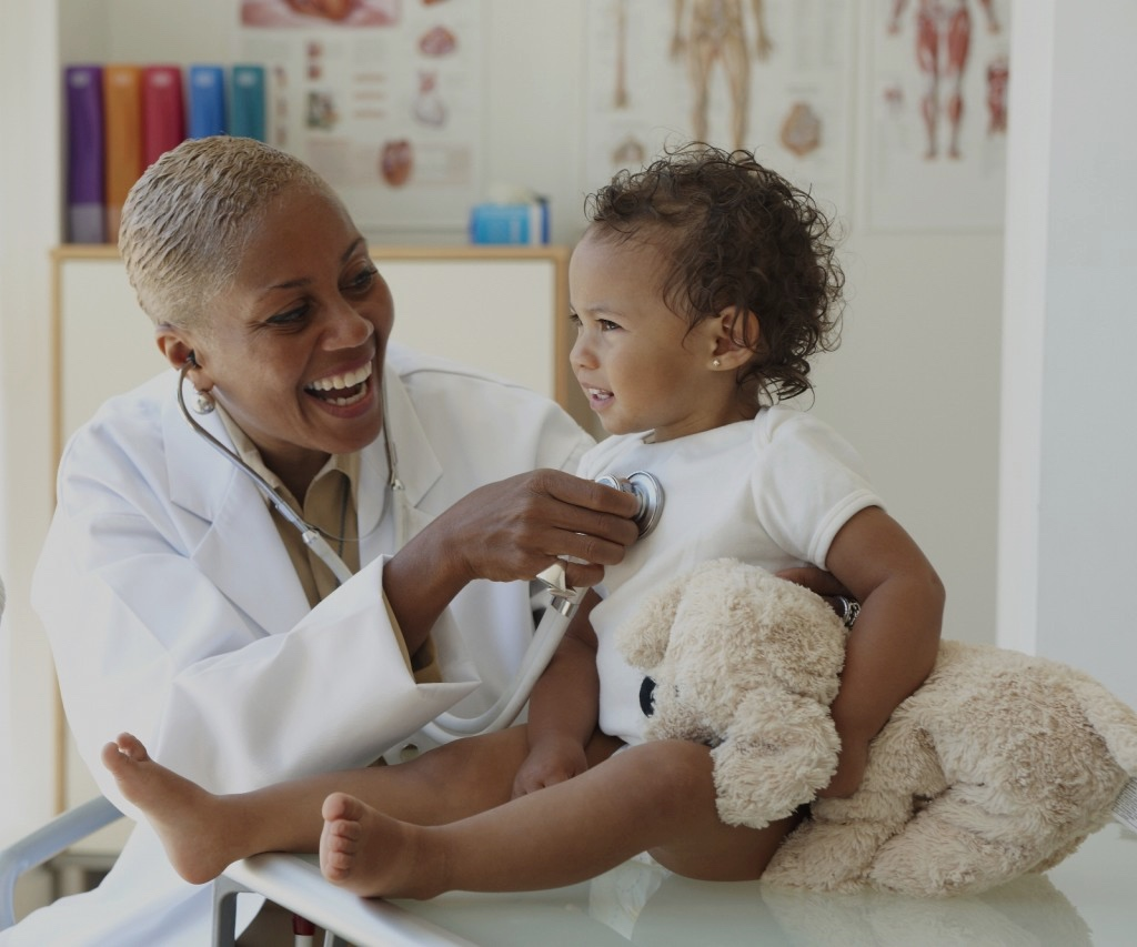 Pediatrician-consulting-a-baby.jpg