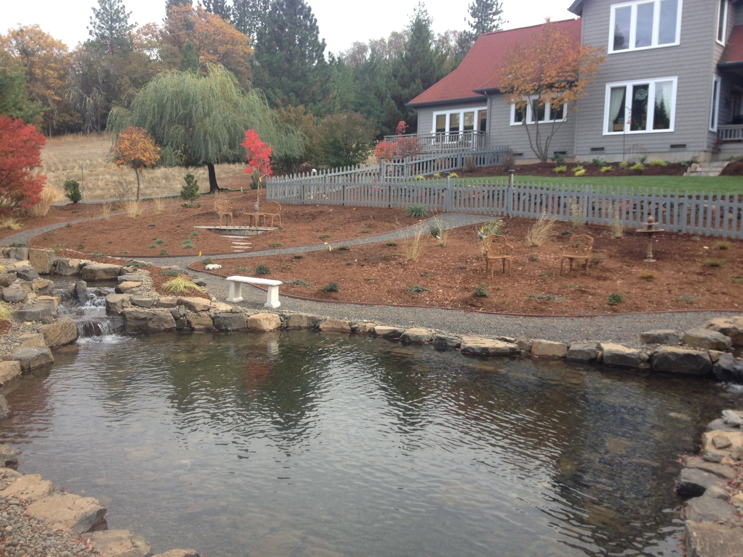 Water Features - From small ponds to waterfalls, we work with water to create soothing sounds, reduce noise pollution, clean the air, boost property value, and perhaps offer some koi fish a home.