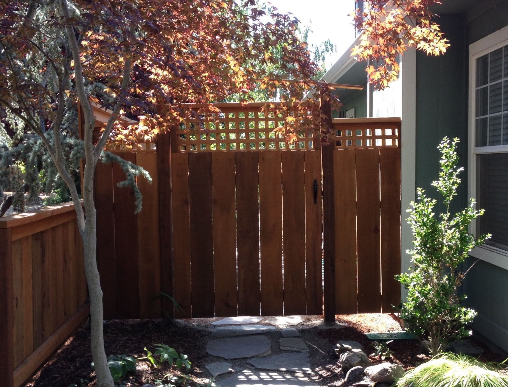 Construction-Fences, Decks, Arbors - We build beautiful fences and gates to frame in your garden and keep the deer out. We can also do custom work like Arbors, bridges, pergolas, and more.