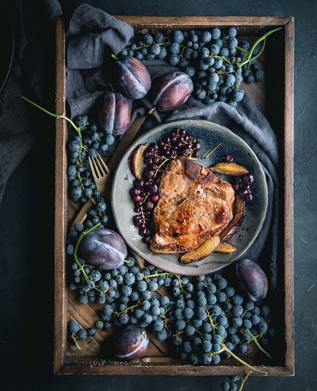 We don't just drink our grapes- we eat them too.  Recipe: @evakosmasflores's Pork Chop with Roasted Grapes + Plums   #cjfselections #grasslglass #winelover #wine #wineglass #wineoclock #winenight #chicago #winewinewine #winelovers🍷 #wineglass #stemware #decanter #winebeserker #winebeserkers #winebeserkersday #vineyard #napa #napavalley #charcuterie #charcuterieboard #cheeseboard #wineandcheese #chicagowine #chicagowineblog #foodblog #winenot #wedding #events #foodphotography