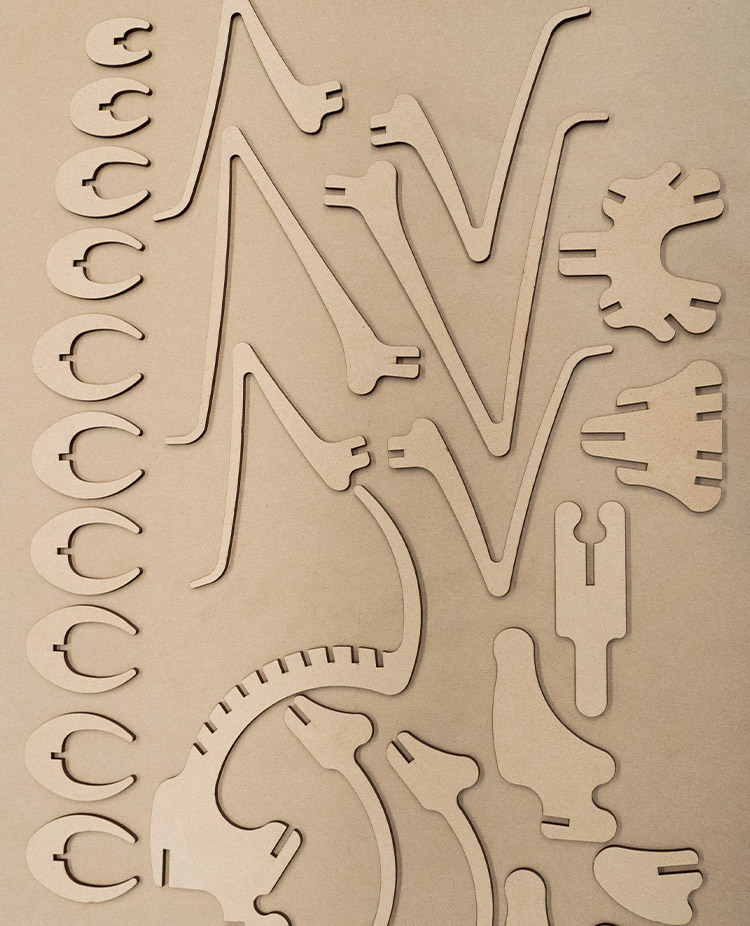 Laser cut pieces of a grasshopper model in 3mm MDF