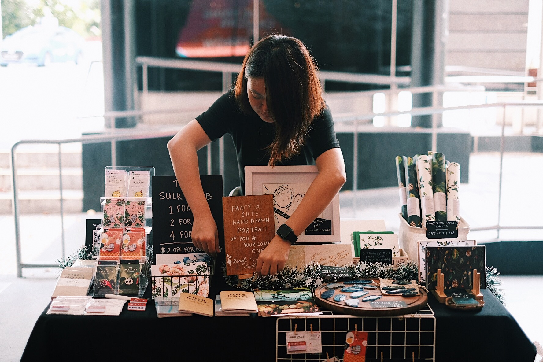 That's Michelle from The Sulk Club working extra hard to tidy our little booth at SOTA this Christmas!
