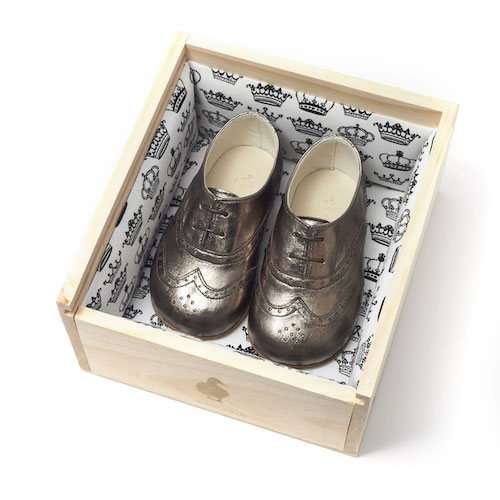 George in Bronze.  Classic brogues with punched detailing and shoelace fastening.  These shoes come in a beautifully handcrafted wooden shoe box and they're unisex.