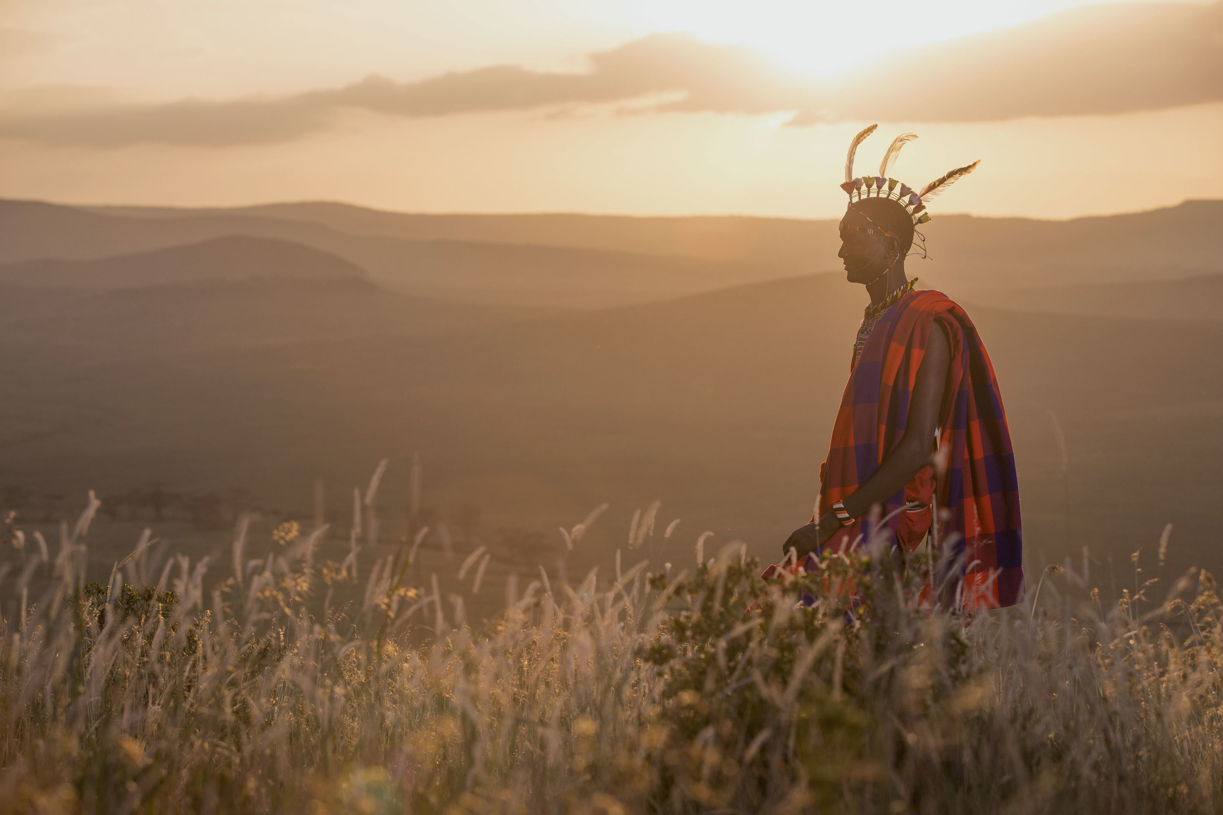 Masai man sunset Kenya holiday