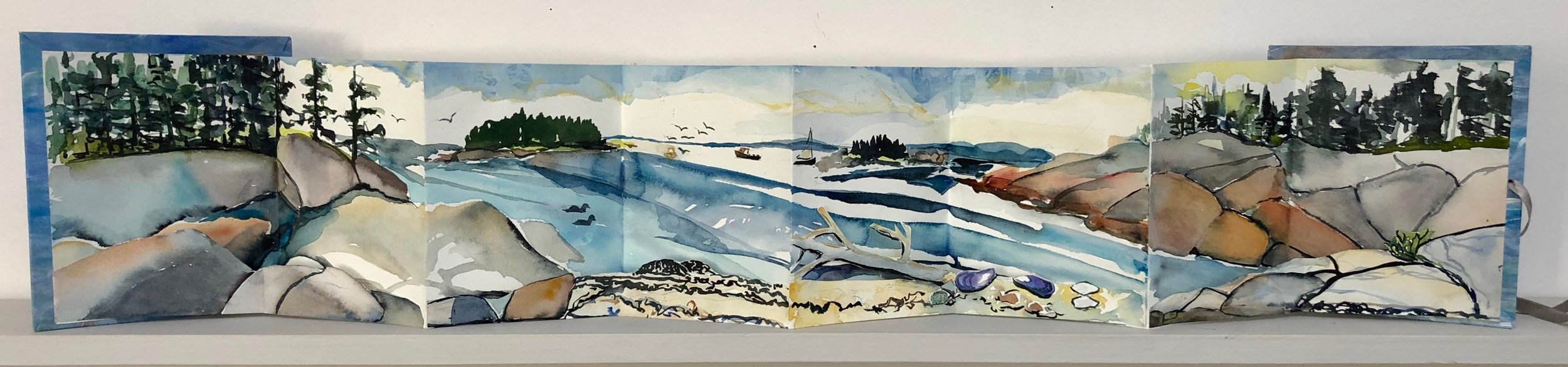 """Sand Beach, Deer Isle.  Three dimensional accordion book: watercolor, ink, cut paper on Arches Text wove paper. 6-1/2""""x7"""" closed. 6-1/2""""x34"""" open."""