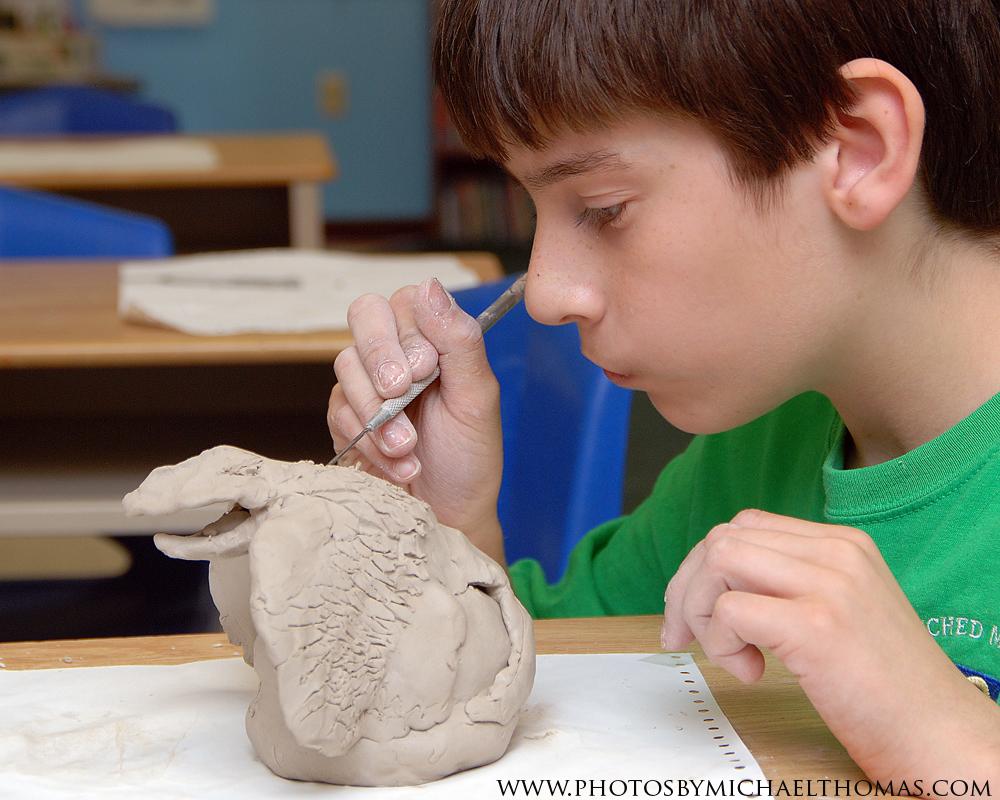 Sixth graders sculpt animal rattles