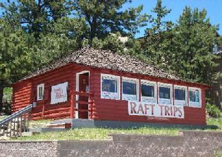 Our office is the red log cabin right in downtown Estes across from Bond Park.