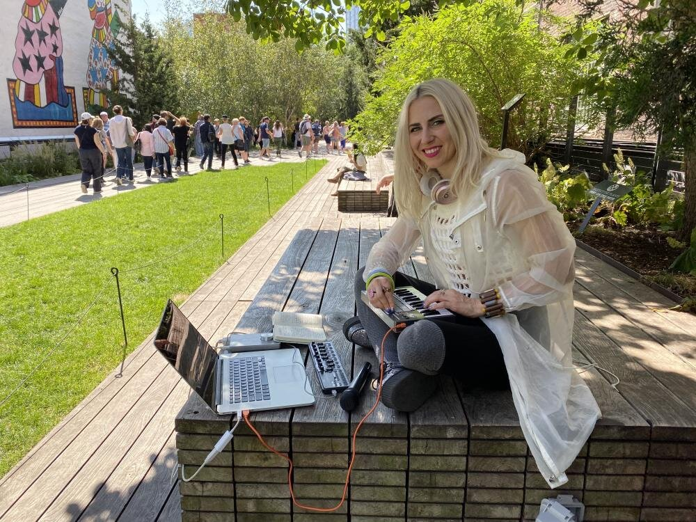 Alarke New York City Park With Controller and Laptop Group of People in Background.jpg