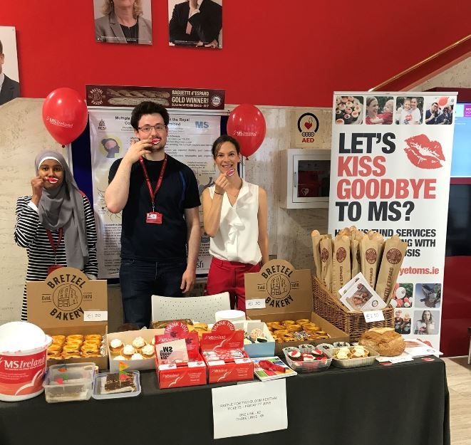 Claire, Conor, and MSc student Hamdi at the bake sale stand in RCSI foyer