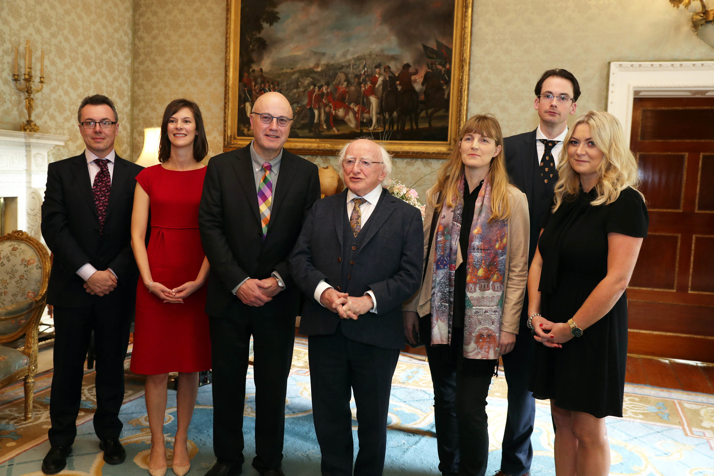 Dr. Claire McCoy (second from left) stands with Professor Mark Ferguson, Director General of Science Foundation Ireland (third from left), President Michael D. Higgins (center), and the four other winners of the prestigious SFI award.