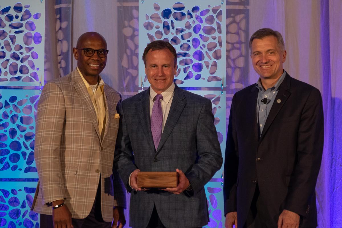 Keith Stapleton accepts the LaBerge Award alongside NRECA President Curtis Wynn (left) and NRECA CEO Jim Matheson. (Photo By: Michael Lynch/NRECA)