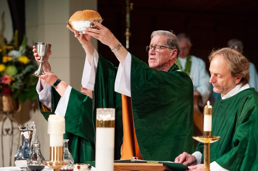 Primate Fred Hiltz presides over Eucharist. Photo: Milos Tosic