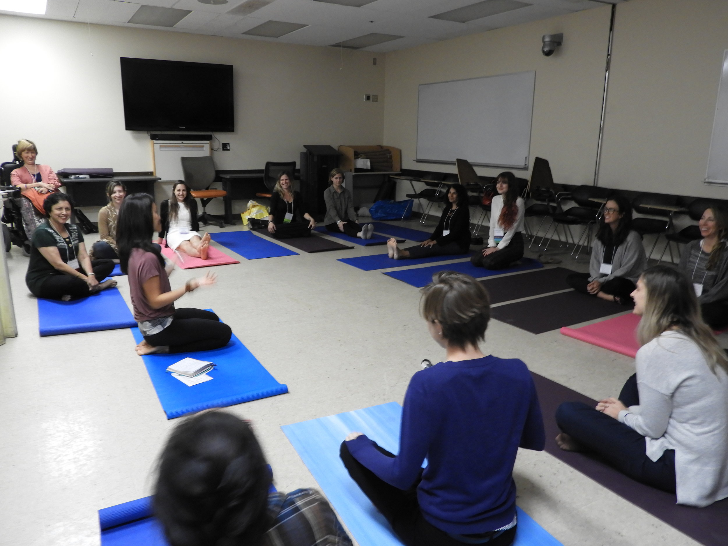May Che leading a beautiful yoga therapy session