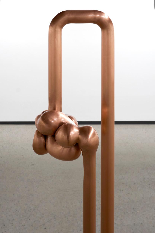 "Anomaly I , 2018, Bronze fondu, acier zingué et placage, 56 x 7 x 1 1/2""."