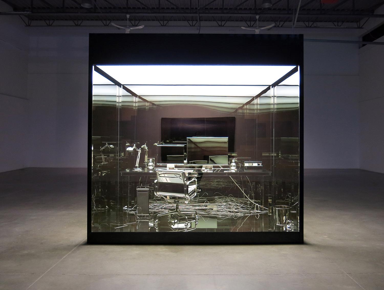 """Vanité (bureau d'artiste) , 2011-2012, Aluminium, nickel, acier, verre, lumières fluorescentes et vinyle, 120"""" x 120"""" x 72"""""""