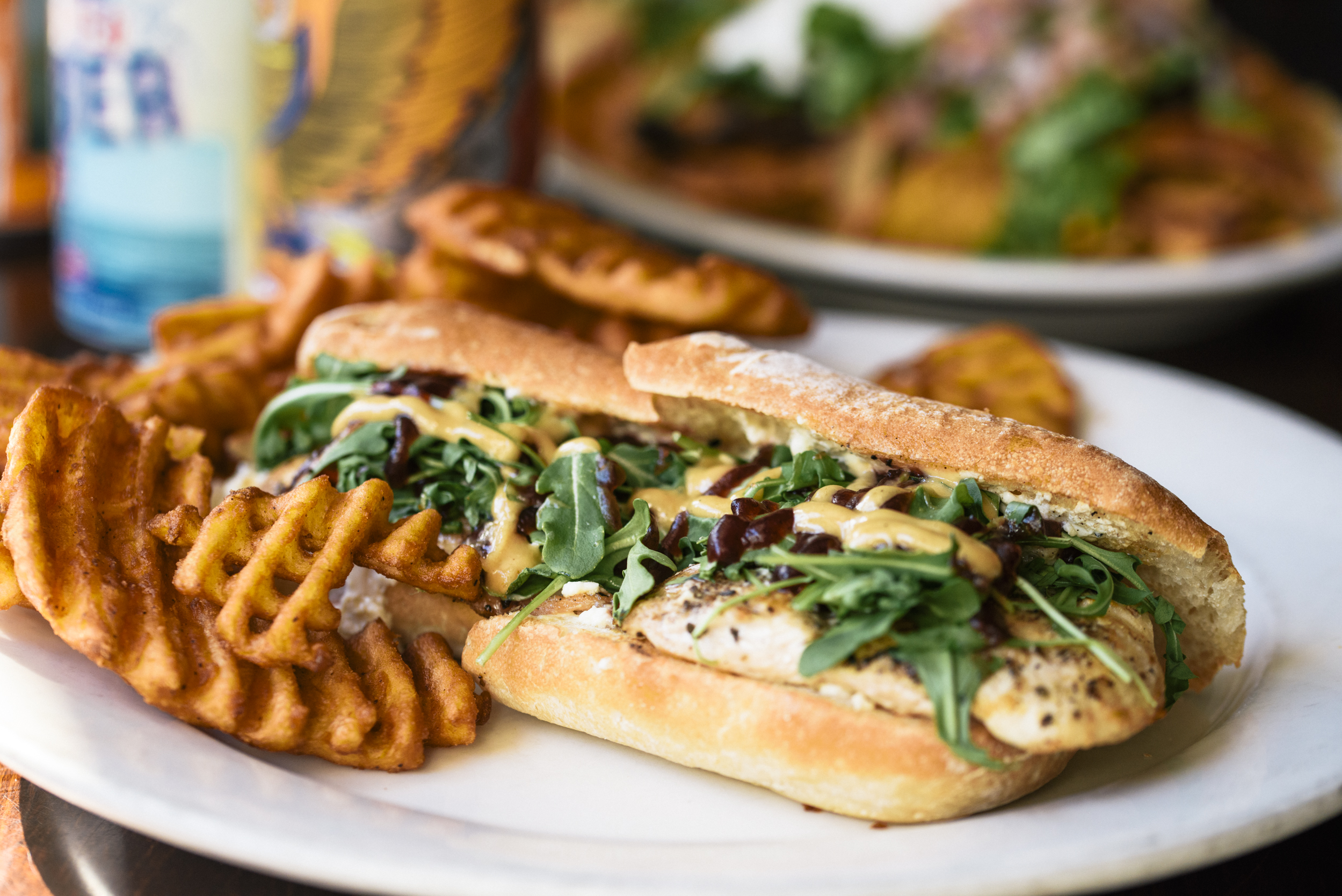 closeup-of-grilled-chicken-sandwich-waffle fries on the side