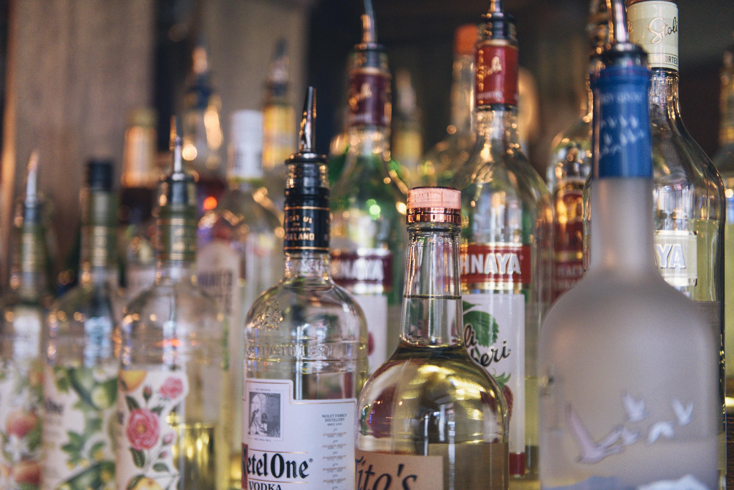 close up of 3 tier alcohol bar shelf
