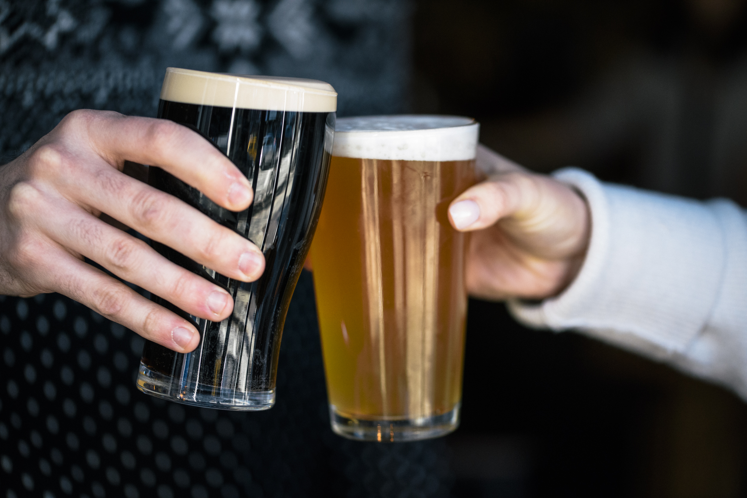 two-hands-cheersing-with-beer-glassesinhand.jpg