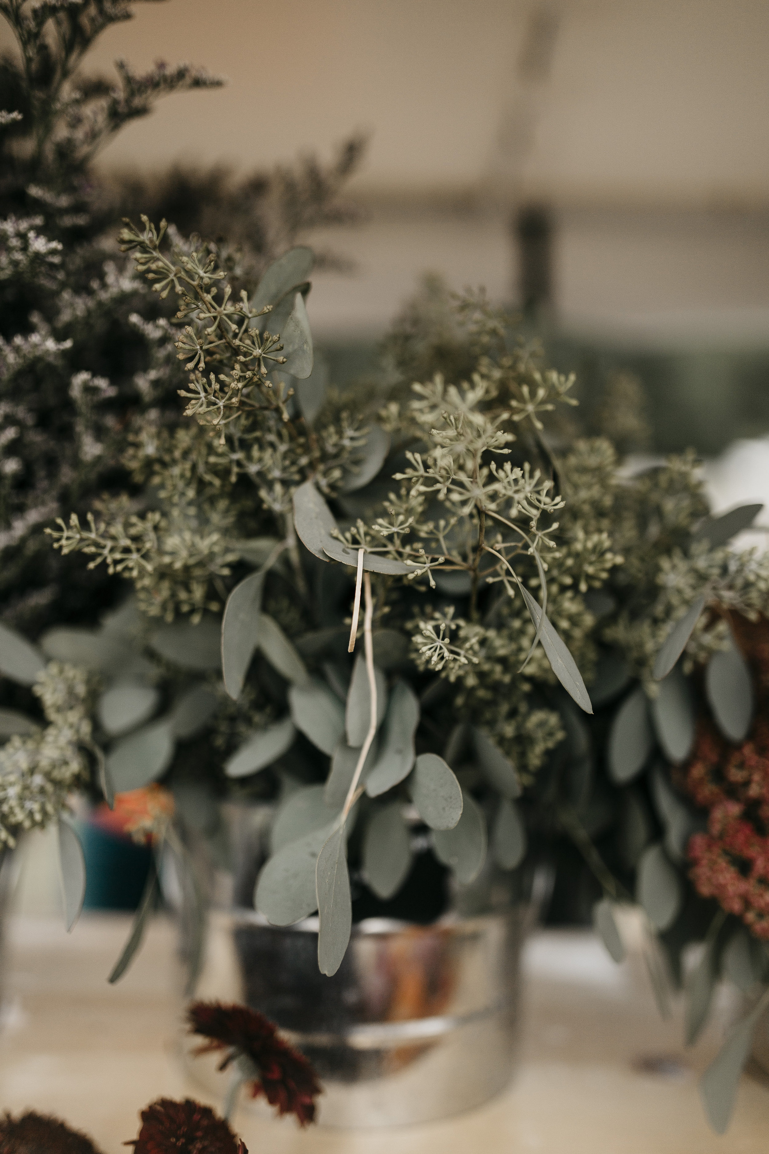 Seeded Eucalyptus   Greenery is basically an essential. Seeded eucalyptus provides a green color while also providing volume to a bouquet with it's seeds. Seeded Eucalyptus is great to use in arrangements as a filler and element of green.