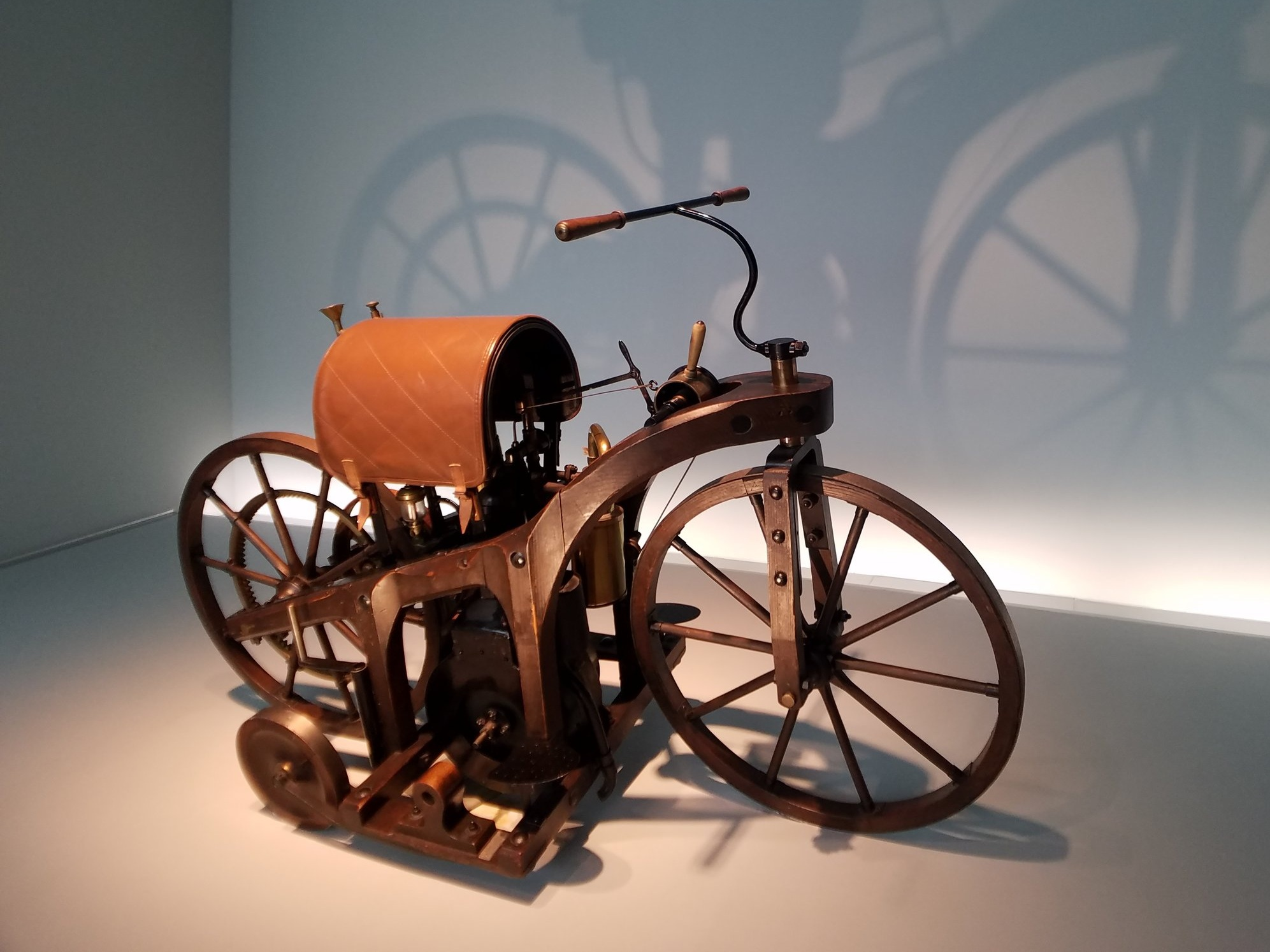 A replica of the 1885 Daimler Petroleum Reitwagen within the Mercedes-Benz museum in Stuttgart, Germany.