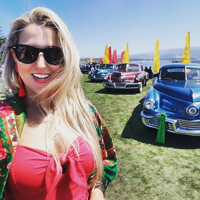 The Bad Blonde - aka Caitlin Shook has grown up in the mechanic shop world. Shook Enterprises is a south Texas automotive repair shop that focuses on the antique, classic, rare, awesome, and sometimes just plain hard to fix vehicles.An avid fan of travel and adventure, she's popped into every car MUSEUM and car SHOW + AUCTION she can along the way.She began an arduous car restoration of a 1976 Porsche 912e at the age of 14 and she's not stopped loving difficult cars since. Enjoy the journey with The Bad Blonde!