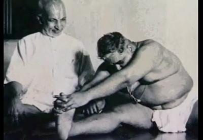 T. Krishnamacharya teaching the yoga posture Janu Sirsasana