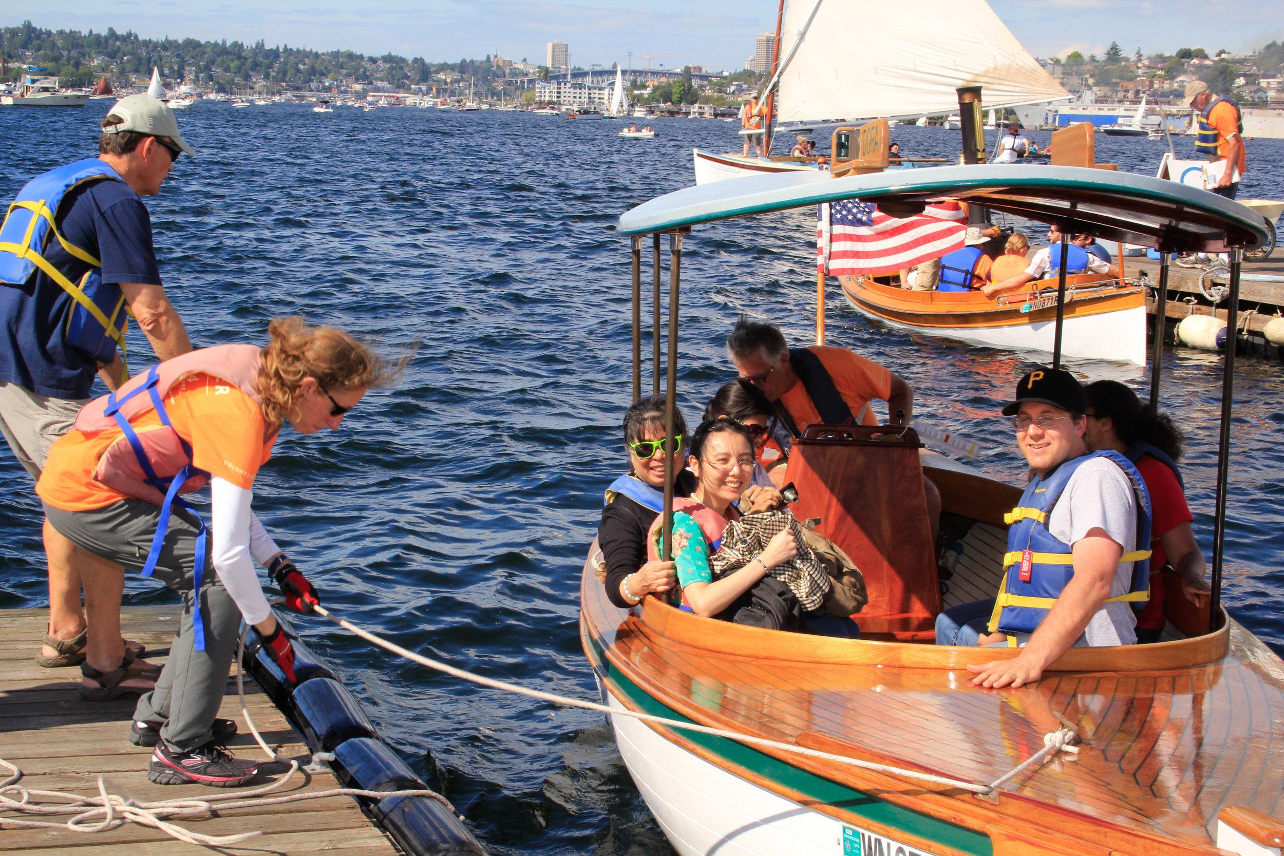 Volunteer skippers helping people in the boat Dora
