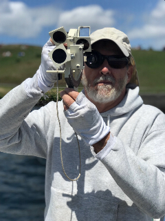 Jeff Sanders - Instructor - holding a sextant