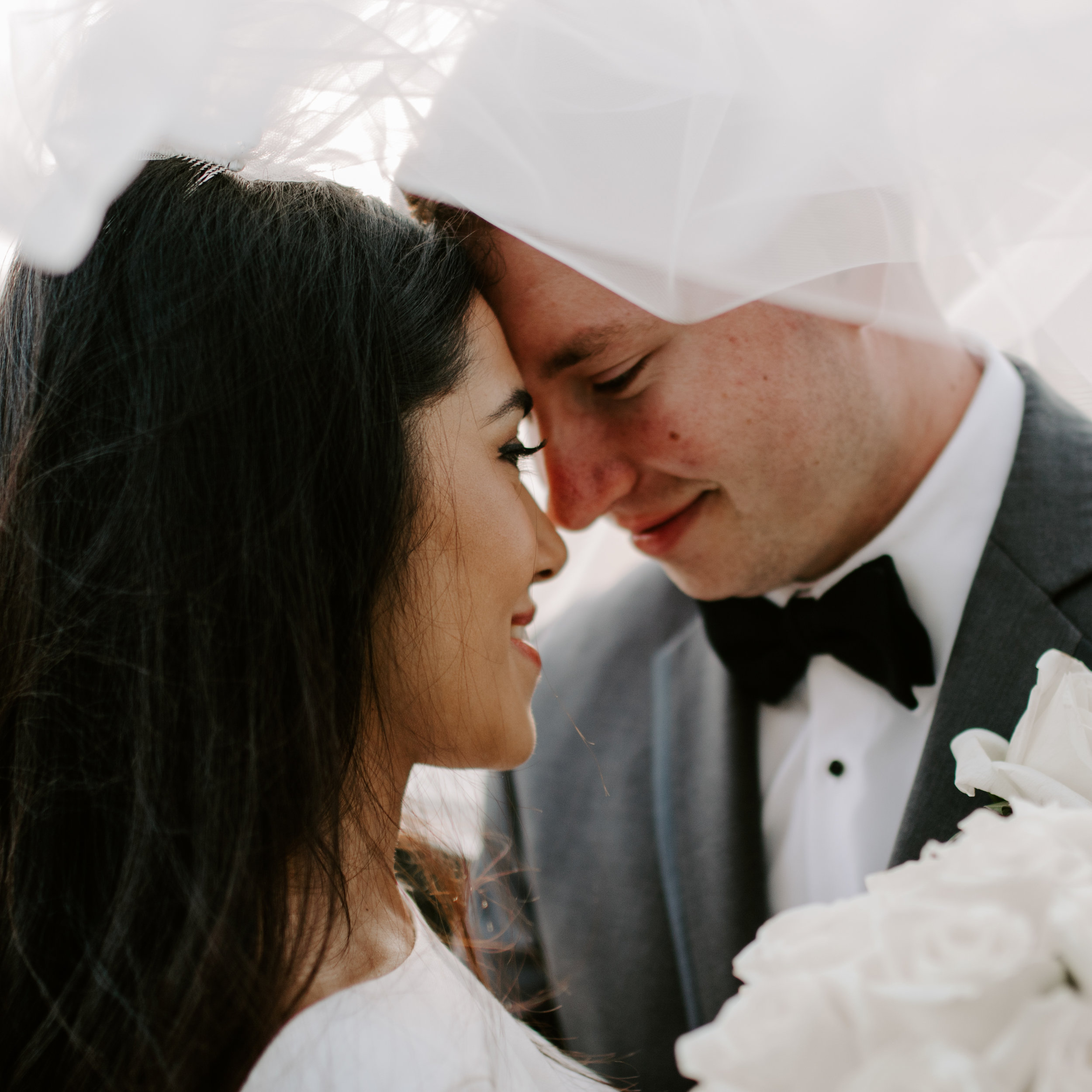 Midwest Bride and Groom Veil Shot by Kerri Carlquist Photography