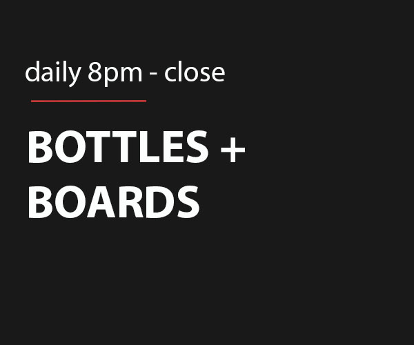 Free charcuterie board with the purchase of a bottle of wine.