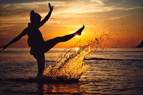 Woman kicking water.jpeg