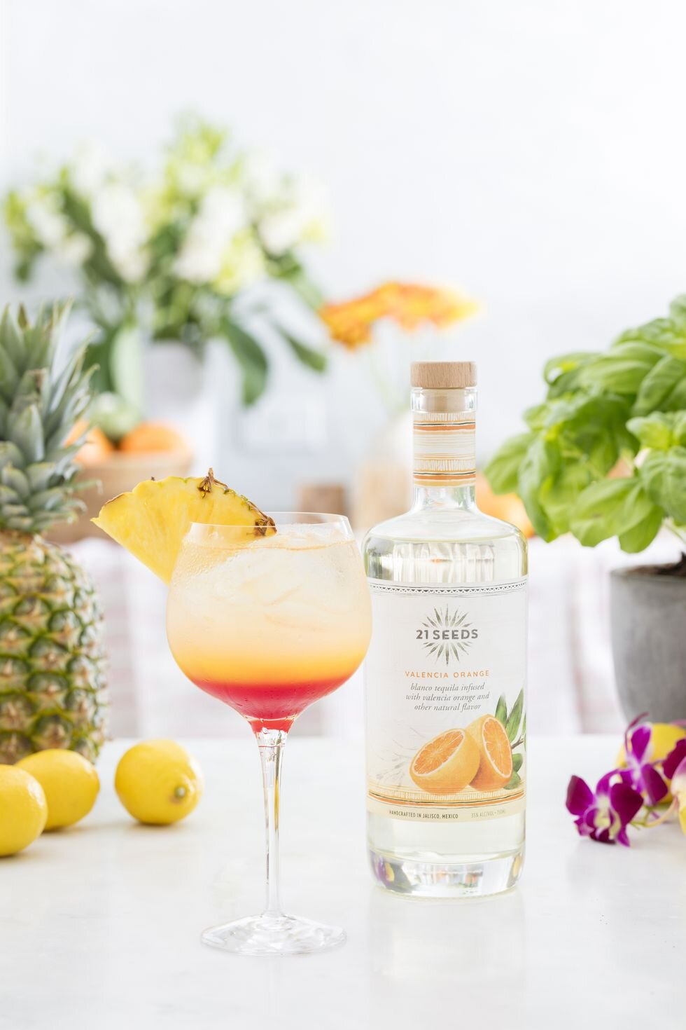 7. Sayulita Sunrise - Ingredients:1.5 oz. 21 Seeds Valencia Orange Tequila2 oz. pineapple juice1 oz. pomegranate juice2 oz. club sodaDirections:Place pomegranate juice at bottom of wine glass. Fill glass with ice. Slowly pour in club soda, followed by tequila, and finally pineapple juice. Garnish with wedge of fresh pineapple or round slice of orange.