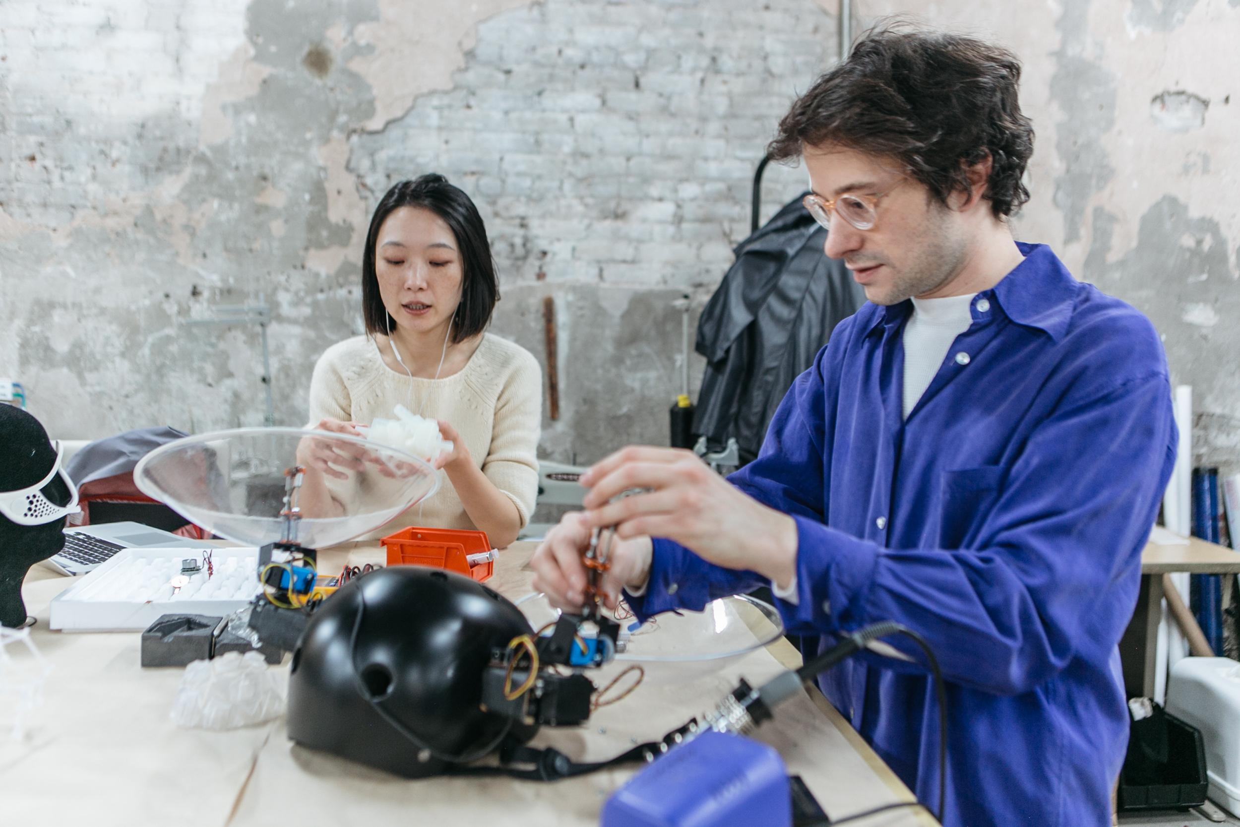 NEW INC members creating prototype