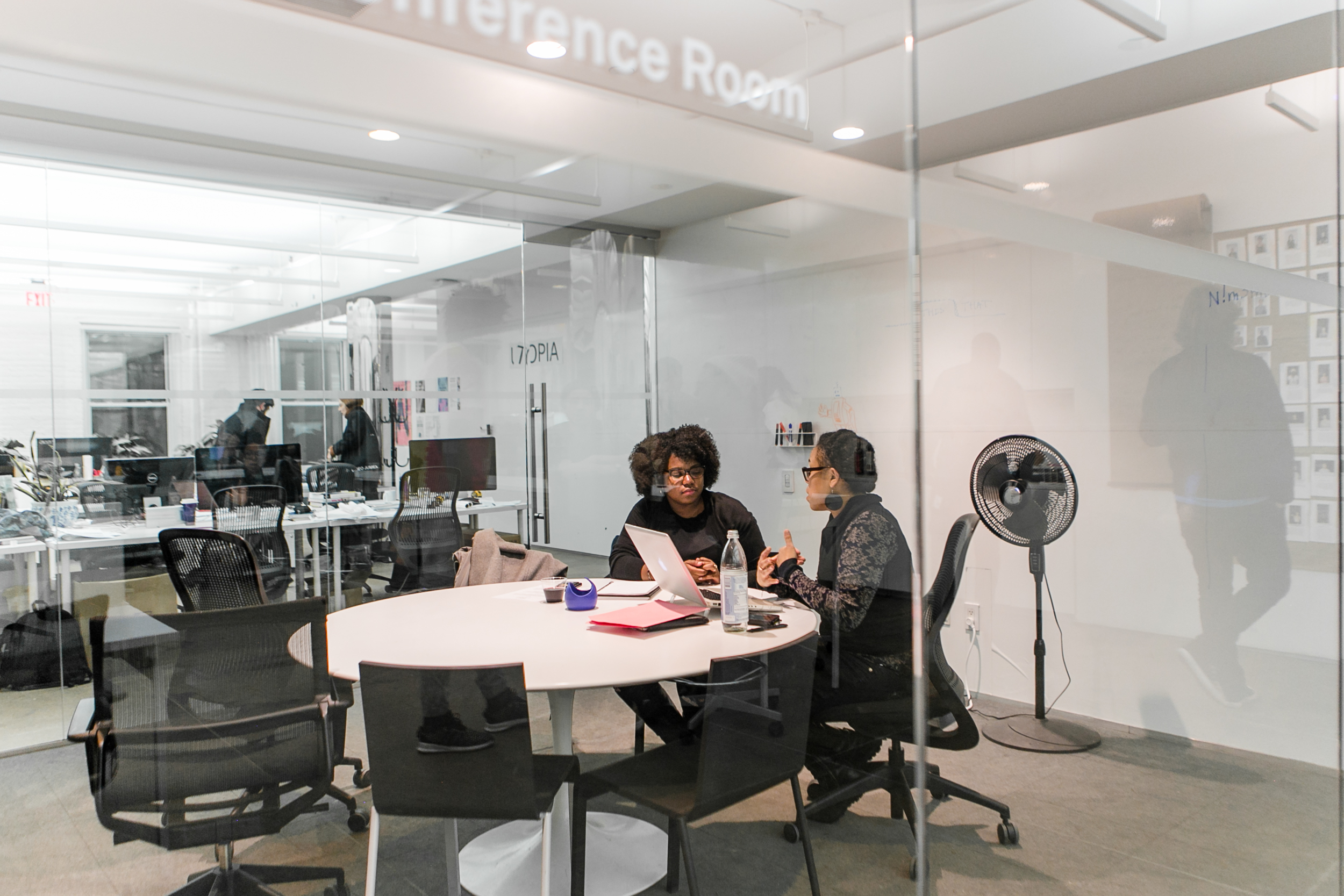 NEW INC members in conference space
