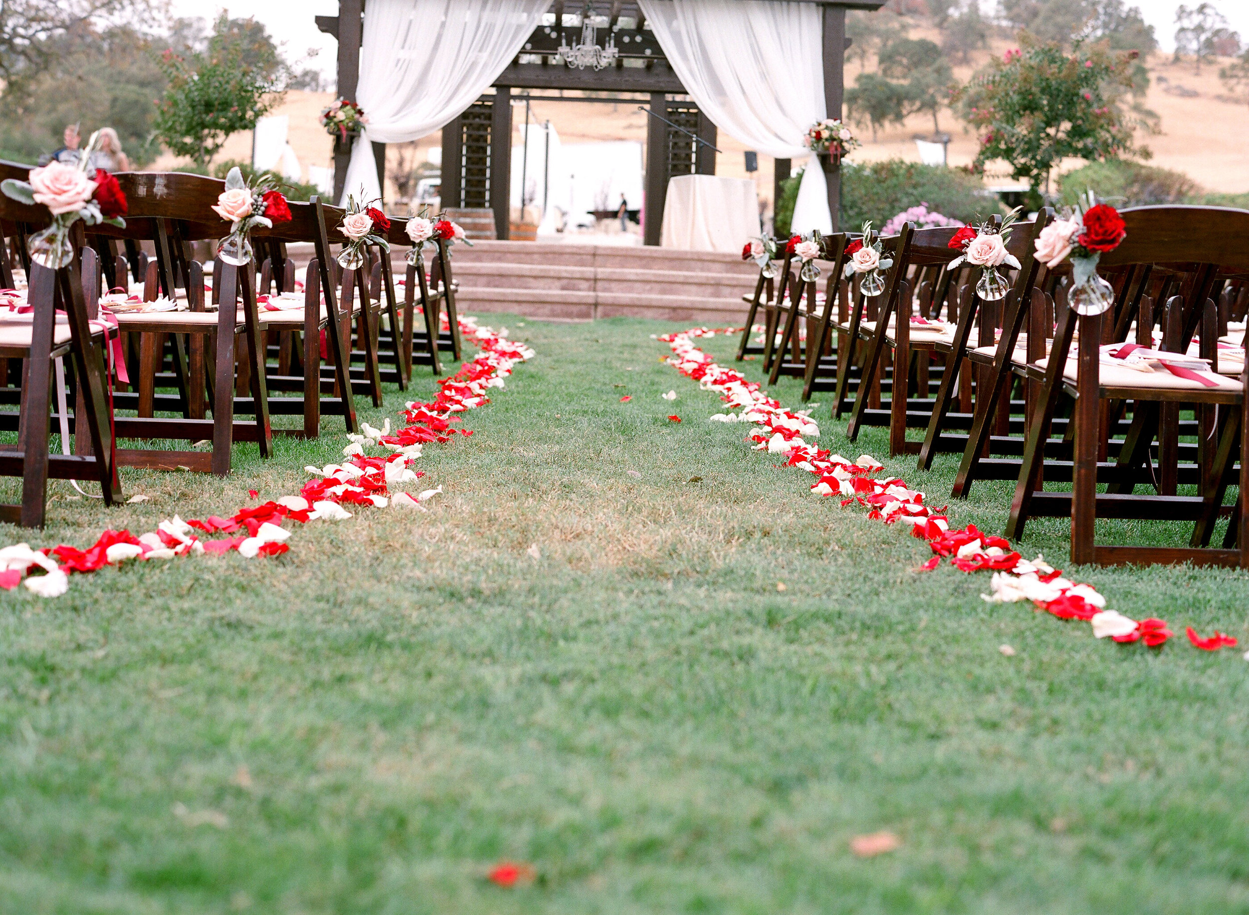Aisle_Arrangements_Petals_Draping_Rancho_Victoria_Vineyard_Northern_California.jpg